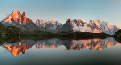 Magical sunset panorama of the Lac Blanc lake and Mont Blanc (Monte Bianco) on background, Chamonix location. Beautiful outdoor scene in Vallon de Berard Nature Reserve, France