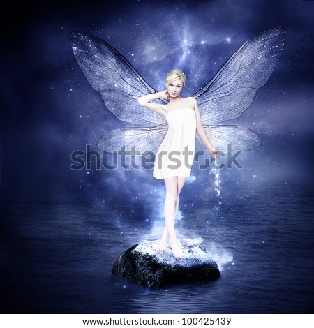 Magical young blond woman as fairy with wings
