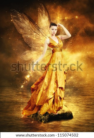 Magical young woman as golden fairy with wings