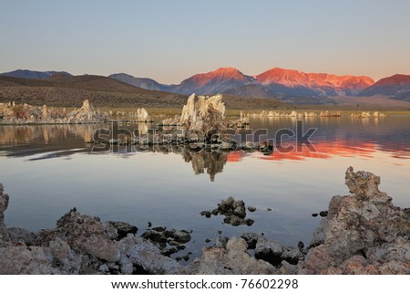 Magically beautiful sunrise. Sunrise at Mono Lake in the crater of an ancient extinct volcano. Shallow lake, a multitude of picturesque reefs Tufa