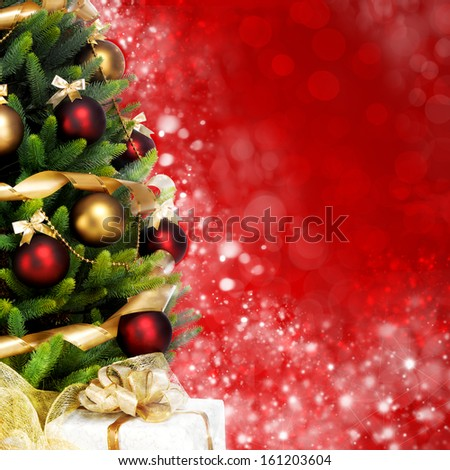 Magically decorated Fir Tree with balls, ribbons and garlands on a blurred Christmas-red shiny, fairy and sparkling background
