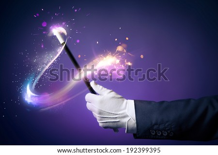 Magician hand with magic wand #192399395