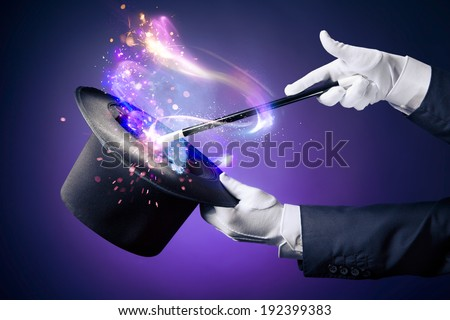 Magician hand with magic wand and hat #192399383