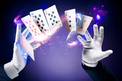 Magician hands with magic cards
