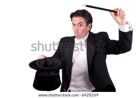 Magician holding a magic wand and a hat isolated over white background
