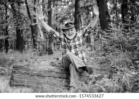 Magician in forest. Herbal remedies. Freak healer. Supernatural or superstitious. Person purported magical abilities. Woodman magician concept. Folk magic. Mature man with beard in hat. Wise old man.