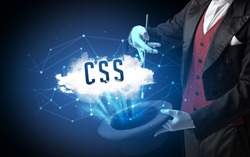 Magician is showing magic trick with CSS abbreviation, modern tech concept