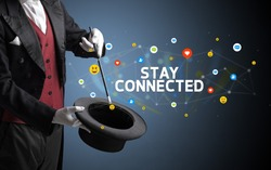 Magician is showing magic trick with STAY CONNECTED inscription, social media marketing concept