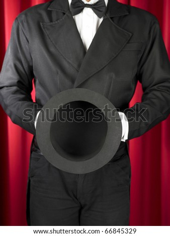 magician offer / showing his empty hat.
