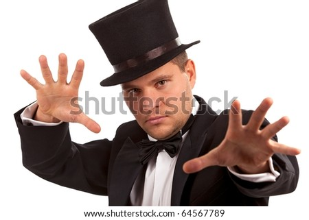 Magician performing a magic trick over white background