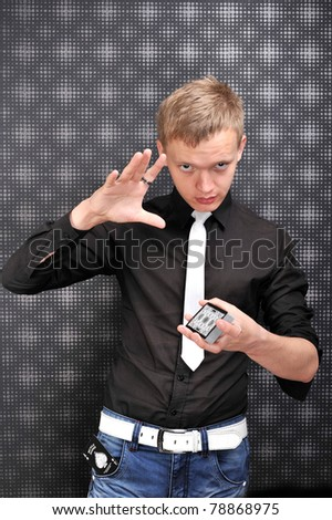 magician shows stunts and tricks with cards, sleight of hand ,glamour background