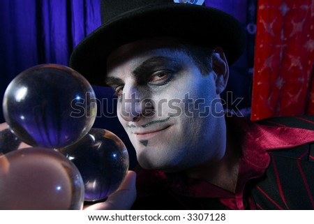 Magician with crystal balls