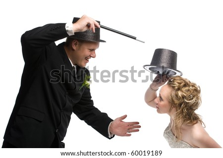 Magician with wand performing magic on young girl