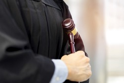 Magistrate or Judge holding the Gavel (Hammer Judge) in His Arms at Court of Law with Lawyer, Justice the Criminal and Illegal Case, Attorney Making Arms Crossed with Hammer - Justice Concept