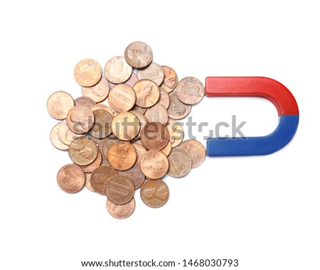Magnet attracting coins on white background, top view. Business concept #1468030793