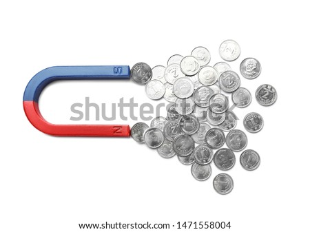 Magnet attracting coins on white background, top view. Business concept #1471558004