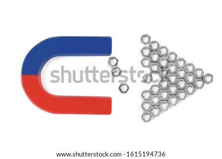 Magnet attracting metal nuts on white background, top view