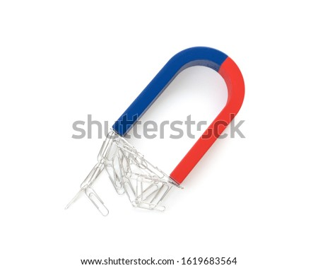 Magnet attracting paper clips on white background, top view