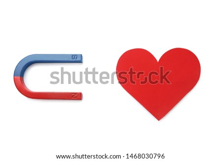 Magnet attracting red heart on white background, top view. Love concept #1468030796