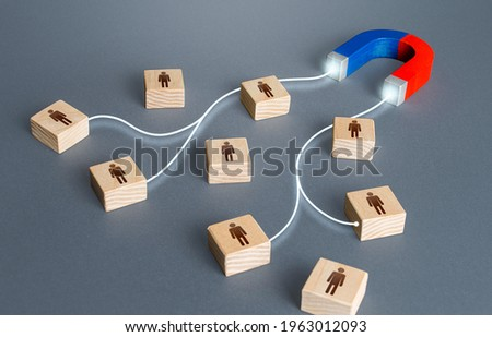 Magnet attracts magnetises certain people candidates blocks. Hiring highly qualified professional staff. Find best talent candidate. Human resources. Team building. Marketing and targeting