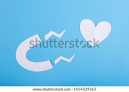 magnet is attracting love on blue background #1414329563