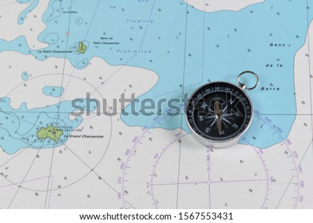 Magnetic compass on a nautical navigational map