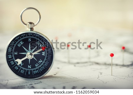 Magnetic compass on world map.Travel, geography, navigation, tourism and exploration concept background. Macro photo. Very shallow focus. #1162059034
