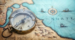 Magnetic old compass on world map. Travel, geography, navigation, tourism and exploration concept background. Treasure Island on the Pirate Map.