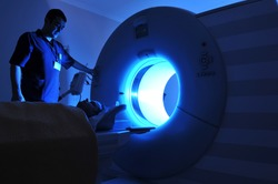 Magnetic Resonance Imaging machine operator and a patient -a series of MRI.