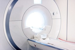 Magnetic resonance imaging (MRI) scanner facade in the hospital room. Medical CT scan system equipment