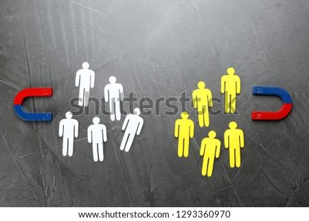 Magnets attracting people traffic on grey background, top view. Business rivalry concept #1293360970