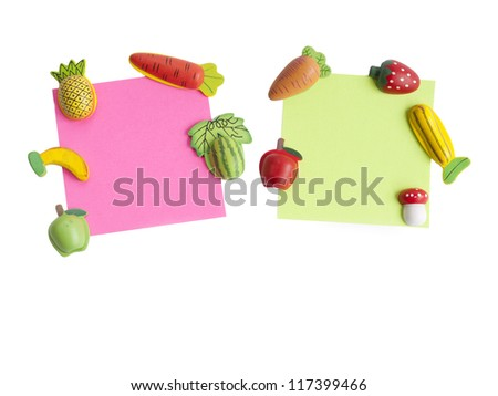 Magnets shaped and colored notepaper - stock photo