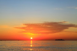 Magnificent, colorful sunset or sunrise at the sea or ocean. Captivating sunrise at the sea. Enchanting sunset at the sea. Ravishing sunrise at the ocean. Glamorous sunset at the ocean.