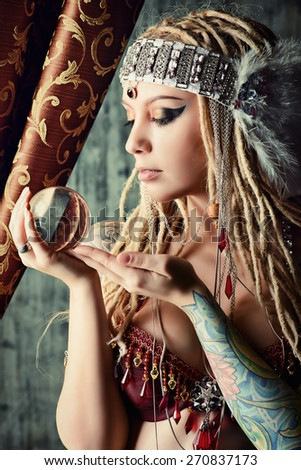 Magnificent fortune teller holding crystal ball  Divination