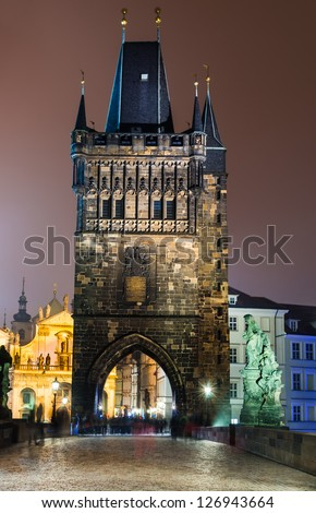 Magnificent Gothic structure called Stare Mesto Tower, was built in 14th century, fitting ornament to the new Charles Bridge (Karluv Most). Prague, Czech Republic