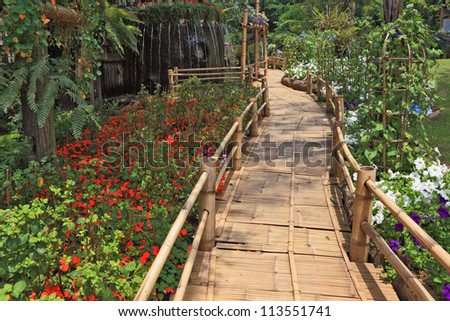 Magnificent huge park on island Madiera. A bamboo path round a fountain