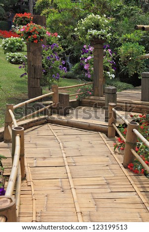 Magnificent huge park on island Madiera. A wooden path among flower beds