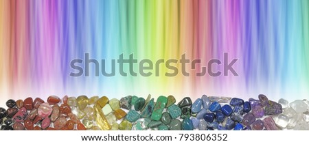 Magnificent Multi-coloured Chakra Healing Stones header - wide rainbow coloured graduated banner copy space above with crystal healer's row of chakra coloured tumbled crystal selection below