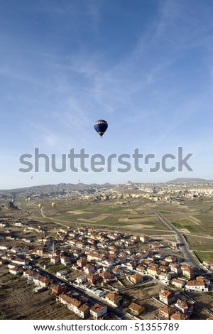 stock-photo-magnificent-view-of-cappadocia-in-turkey-with-hot-hair-balloon-in-blue-sky-51355789.jpg