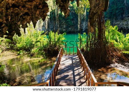 Magnificent view of the mystery misty cave in the jungle in the underground lake. The 3 Eyes National Park (Los Tres Ojos) in Santo Domingo, Caribbean, Dominican Republic Zdjęcia stock ©