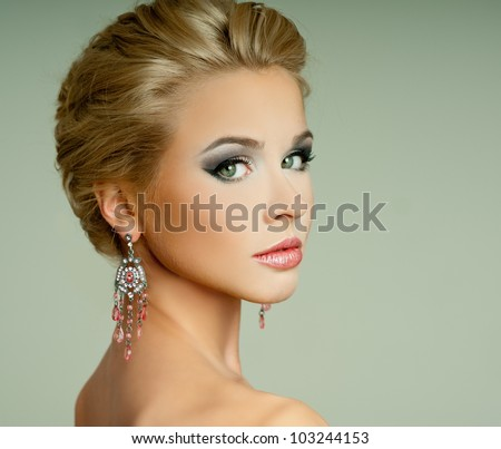 magnificent woman in expensive earrings