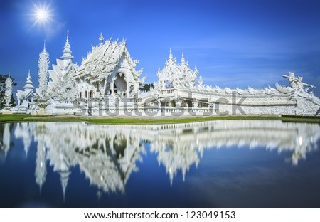 Magnificently grand white church and reflection in the water, Rong Khun temple, Chiang Rai province, northern Thailand