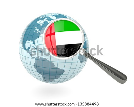 Magnified flag of united arab emirates with blue globe isolated on white