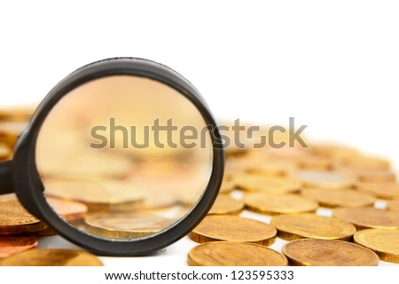 Magnifier and coins. On a white background.