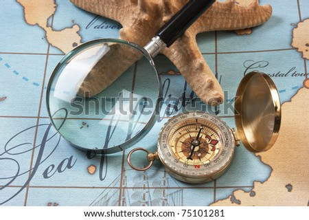 magnifier and compass on a stylized map