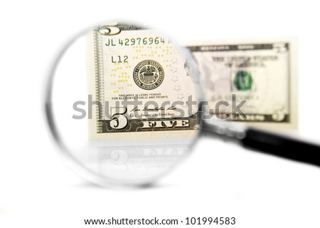 Magnifier and money. On a white background.