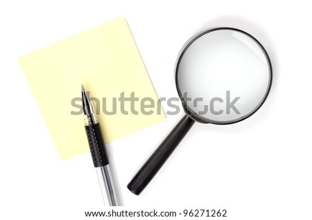 Magnifier,pen and notepaper