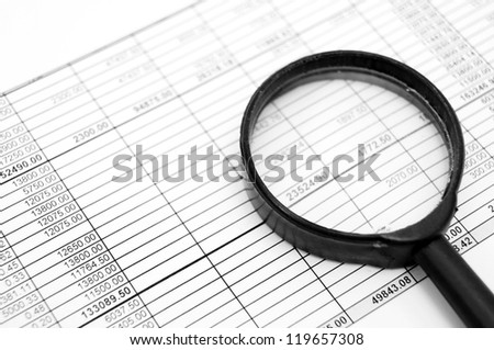 Magnifiers and documents. Accounts department.