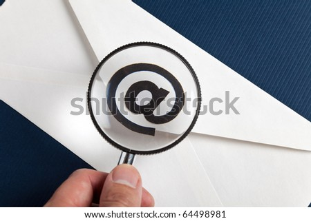 Magnifying Glass and e-mail, concept of E-Mail Security