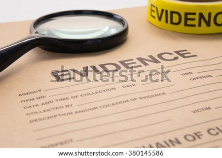 magnifying glass and evidence bag for detective and crime scene investigation